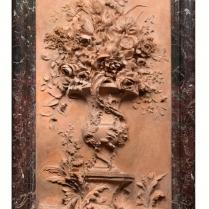 Haut relief en platre patine à l'imitation de la terre cuite
